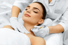 face-skin-care-diamond-microdermabrasion-peeling-treatment-bea-closeup-beautiful-woman-getting-beauty-spa-salon-cleansing-63738704